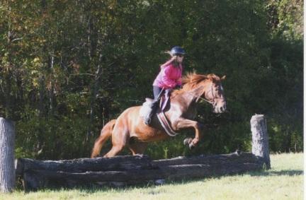 MJ & Cini Jumping - Pomfret Fall 2014.jpeg